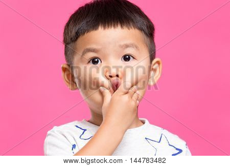 Little boy with hand touch on his cheek