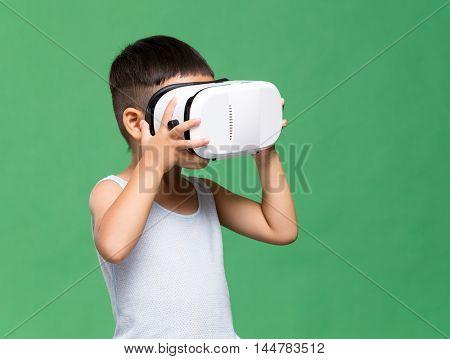 Little boy uisng virtual reality device
