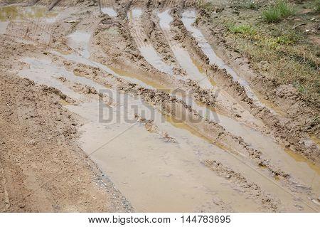wheel tracks on wet soil in garden