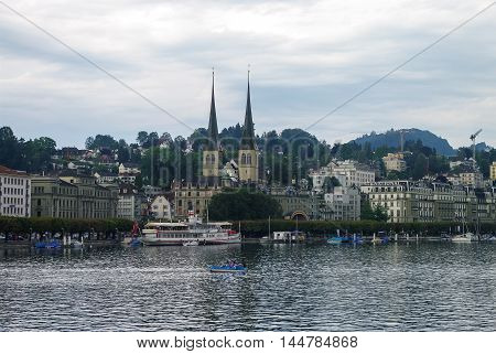 Lucerne, Switzerland - 20 August, 2010: View of old town and lake with the towers of the Church of St. Leodegar.