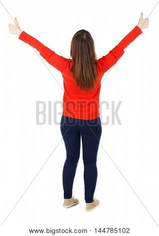 Back view of woman thumbs up. The girl in the red sweater held up both hands with thumbs up.
