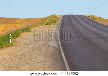 Way in the deserted area.Open road.The highway in the desert.