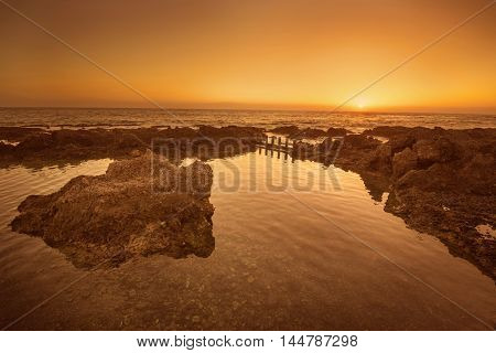 Idyllic golden sunset in the ocean. Alcala Tenerife Canary island Spain.