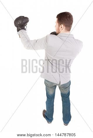 businessman with boxing gloves in fighting stance. backside view of person. Top view of a businessman with boxing gloves.