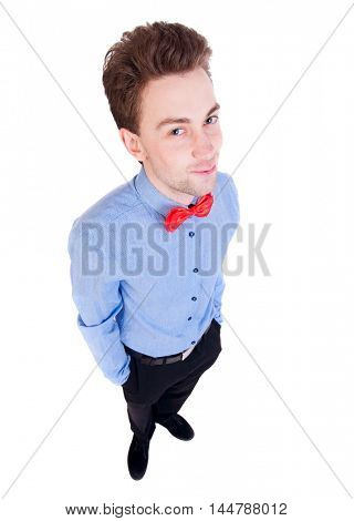 Smiling businessman in a bow tie looking up. top view. on white background.Satisfied businessman looking through a frame.