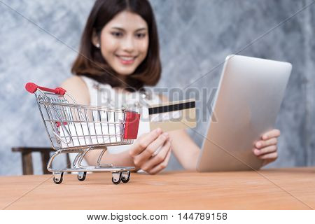 beautiful shopping online with laptop and credit card shopping and business concept soft focus