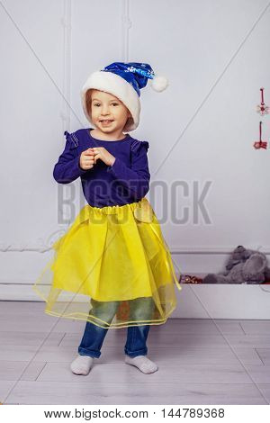 Beautiful little girl dancing. The concept of New Year and Christmas