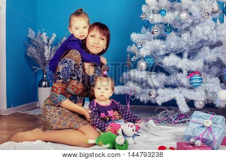 mother of two daughters. The concept of New Year and Christmas
