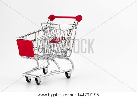 Mini shopping cart isolated on white background