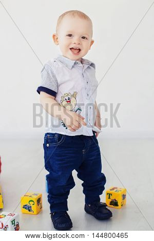 little boy laughing and having fun in cubes