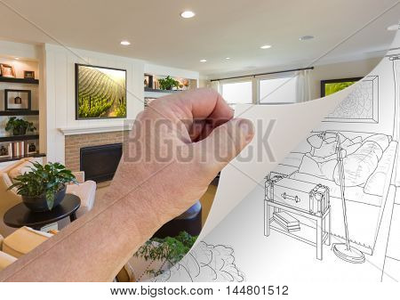 Male Hand Turning Page of Custom Living Room Photograph to Drawing Underneath. Images on walls are my copyright and released with attached releases. Check portfolio.