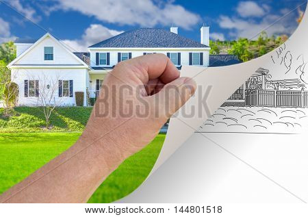 Male Hand Turning Page of Custom Home Photograph to Drawing Underneath. The property release attached is for the date the property was photographed NOT the background image.