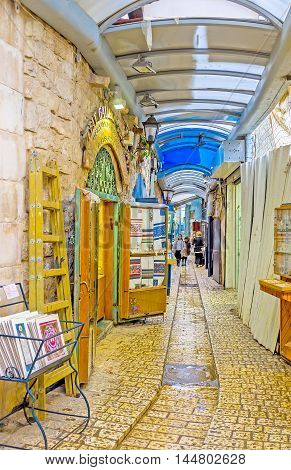 SAFED ISRAEL - FEBRUARY 22 2016: The Gallery Street is the long and narrow covered market with many tourist stalls art galleries workshops and craft centers on February 22 in Safed.