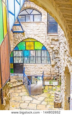 The narrow descent is the branch of the Gallery street leading down the of hilly old town Safed Israel.