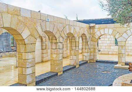 TABGHA ISRAEL - FEBRUARY 22 2016: The courtyard of the Multiplication Church with the numerous stone arches on February 22 in Tabgha.