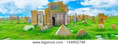 The large area of Noratus Cemetery covered with stone khachkars boasting amazing carved patterns Gegharkunik Province Armenia.