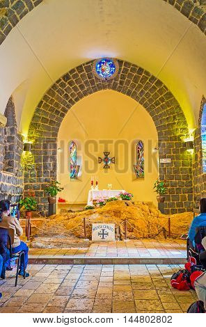 TABGHA ISRAEL - FEBRUARY 22 2016: The prayer hall of the Church of the Primacy of St Peter with the large limestone block at the Altar named Mensa Christi (the Table of Christ) on February 22 in Tabgha.