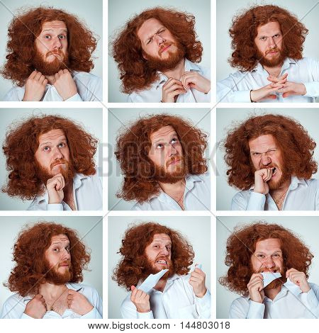 The young man with long red hair posing on gray background with funny face expressions