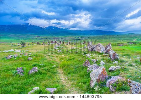 The long alley leads to the circles of ancient stones of Zorats Karer archaeological site Sisian Syunik Province Armenia.