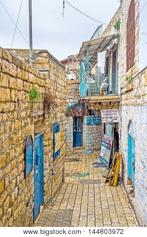 SAFED ISRAEL - FEBRUARY 22 2016: The narrow stone street of the oldtown located in highlands of Galilee on February 22 in Safed.