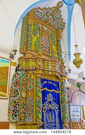 SAFED ISRAEL - FEBRUARY 22 2016: The Torah Arc in Ari Ashkenazi Synagogue made of the olive wood and decorated with colorful carved patterns on February 22 in Safed.