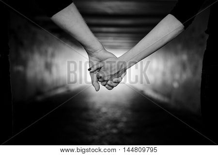 happy couple holding hands black and white