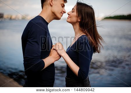 Side view of romantic young couple kissing outdoor