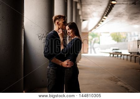 Side view of a couple standing and hugging