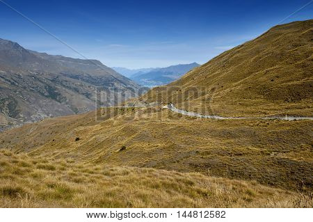 Scenic Viewpoint Of Road, Mountains, And Lake In South Island Of New Zealand