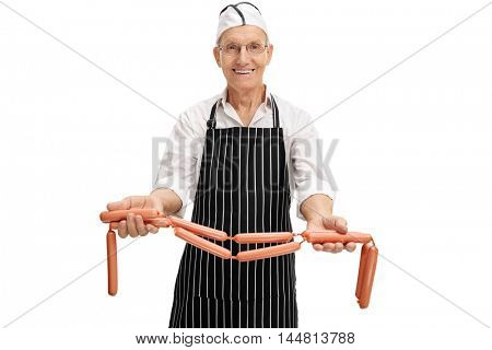 Elderly butcher showing some raw sausages isolated on white background