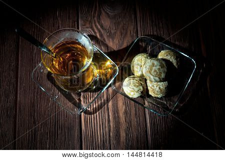 tea with cookies on the wooden table