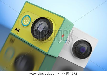 Small Ultra HD Action Cameras on a blue background. 3d Rendering