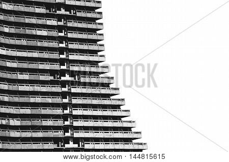 Old unfinished panel multi-storey building on a white background in black and white colors.