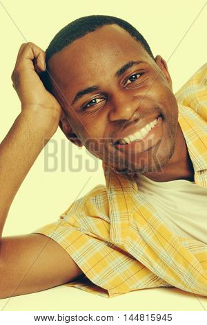 Happy smiling young black man