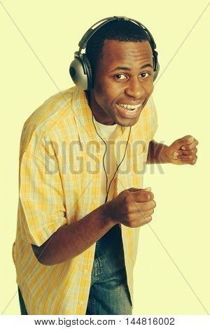 Young black man dancing listening to music