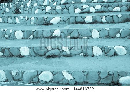 stone steps closeup with a spotty striped pattern of pale indigo color for the abstract background or for wallpaper