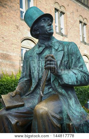 Monument of Hans Christian Andersen standing next to Radhus Copenhagen city hall Copenhagen Denmark