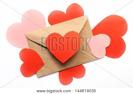 concept of mail envelope from which messages are emitted in the form of hearts on top of the form / expression of love in a letter