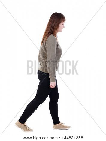 back view of walking woman. beautiful blonde girl in motion. Isolated over white background. She goes down to the right hand.