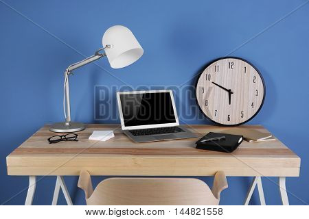 Working place on blue wall background
