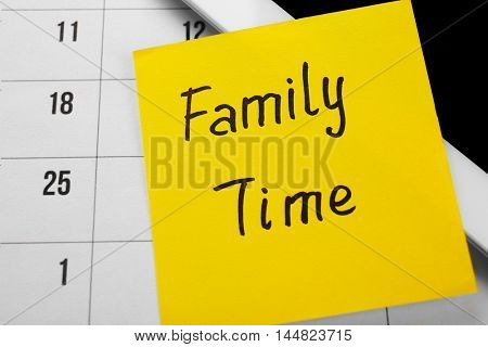 Note with text FAMILY TIME, closeup