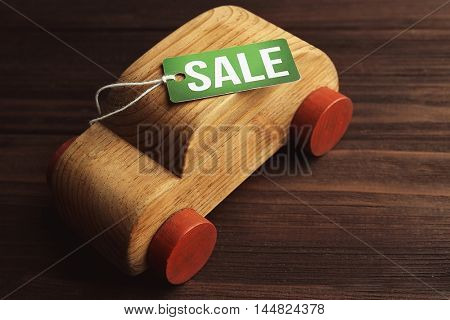 Sale label on wooden toy car