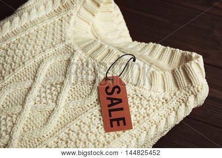Sale label on sweater, closeup