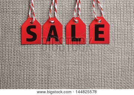 Sale labels on fabric background