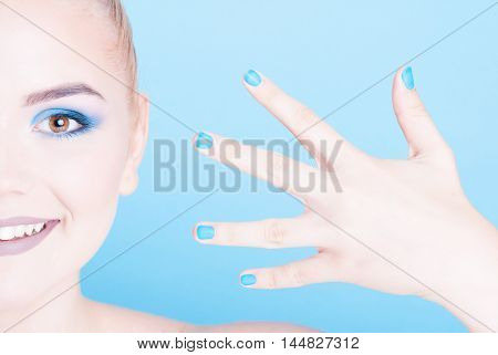 Half Face Of Woman With Matching Nails And Make-up