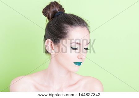 Woman Posing With Professional Green Trendy Make-up