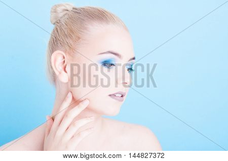Lady Posing Side View With Matching Polish And Make-up