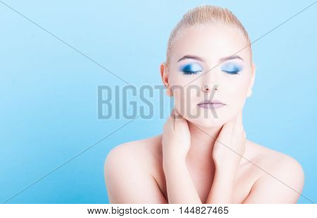 Girl Wearing Professional Make-up Posing With Eyes Closed