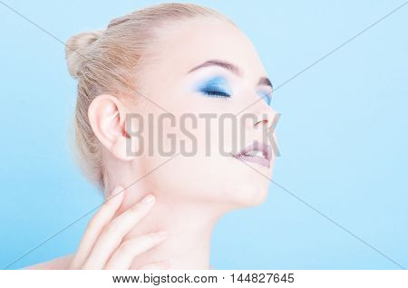 Woman Posing Side View With Matching Nails And Make-up