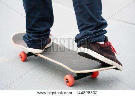 Skater on skate on the side of half pipe